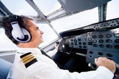 Pilot flying an airplane Royalty Free Stock Images