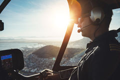 Pilot flying a helicopter Royalty Free Stock Image
