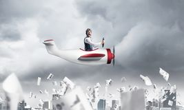 Pilot flying in small paper airplane royalty free illustration