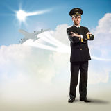 Pilot is in the form of arms crossed. Pilot is in the form of arms folded, against the sky, the clouds and the plane Stock Photos