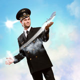 Pilot in the form of extending a hand to airplane Stock Image