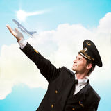 Pilot in the form of extending a hand to airplane Royalty Free Stock Images