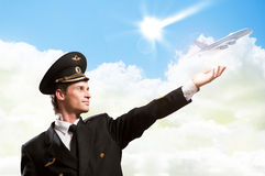 Pilot in the form of extending a hand to airplane Stock Photos