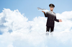 Pilot in the form of extending a hand to airplane Royalty Free Stock Photos