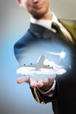 Pilot in the form of extending a hand to airplane Royalty Free Stock Photo