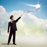 Pilot in the form of extending a hand to airplane Royalty Free Stock Photography