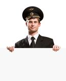 Pilot in the form of holding a blank banner Stock Photo