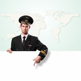 Pilot in the form of holding an empty billboard Stock Image
