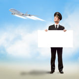 Pilot in the form of holding an empty billboard Stock Photos