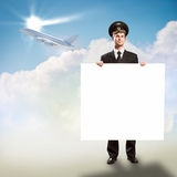 Pilot in the form of holding an empty billboard Royalty Free Stock Photo