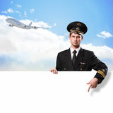 Pilot in the form of holding an empty billboard Royalty Free Stock Photos