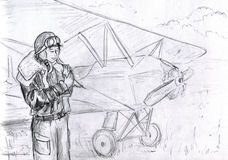 Pilot girl with a bird. Pilot girl holding a bird in her hands. The airplane is seen behind her Royalty Free Stock Images