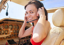 Pilot girl in cabin of little plane Stock Image