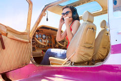 Pilot girl in cabin of little plane Royalty Free Stock Photography