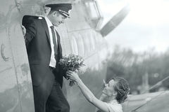 Pilot and girl near vintage aircraft royalty free stock photos