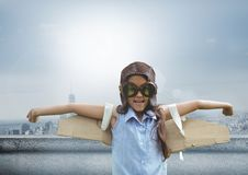 Pilot girl with wings over city background Stock Photography