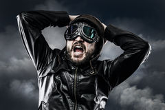 Pilot with glasses and vintage hat with expression of surprise Stock Photo