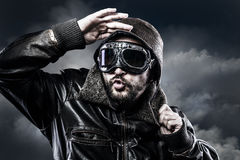 Pilot with glasses and vintage hat with funny expression Stock Photos