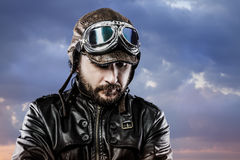 Pilot with glasses and vintage hat with proud expression over cl Royalty Free Stock Photography