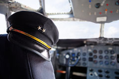Pilot hat in an airplane Royalty Free Stock Photography