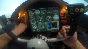 Pilot having problem with aircraft flight control system, hand knocking on panel. Stock footage stock footage