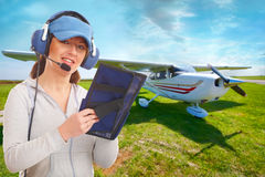 Pilot with headset and knee-pad royalty free stock photos