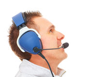 Pilot with headset looking aside Stock Photos
