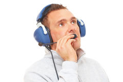 Pilot with headset looking aside Stock Photo
