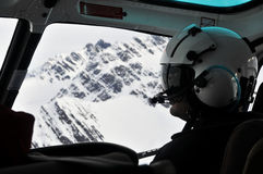Pilot of helicopter. Pilot flying around Andes range Royalty Free Stock Images
