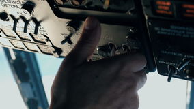 The pilot of the helicopter is preparing for the flight. stock footage