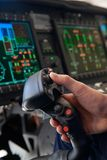 Close Up Pilot Holding Joystick In Helicopter Cockpit Stock Images