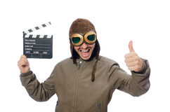 The pilot holding movie clapboard on white Stock Image