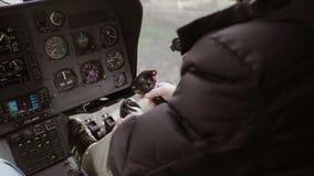 Pilot im Hubschrauber stock video footage