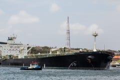 Pilot Leading Huge Tanker Arkivfoto