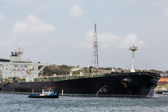 Pilot Leading Huge Tanker Stock Photo