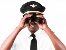 Pilot looking through Binoculars Stock Photo