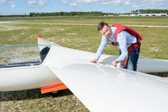 Pilot looking at wing sailplane Stock Photo