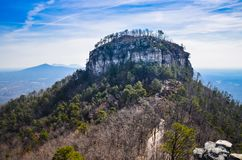 Pilot Mountain, North Carolina. White quartzite rock tops Pilot Mountain in North Carolina giving natural beauty to the area and enticing climbers and hikers stock image
