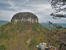 Pilot Mountain State Park Pinnacle. A rocky ledge overlooks the pinnacle under blue skies at Pilot Mountain State Park in North Carolina stock images