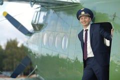 Pilot near vintage aircraft Stock Images