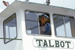 The pilot of the Oxford Ferry looking out the window of his bridge, Chesapeake Bay, Maryland Stock Images