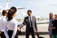 Pilot and passenger shake hands Stock Photos