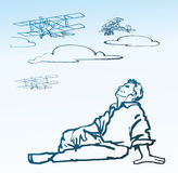 Pilot. People dreamer pilot looking to the sky on the retro biplane aircraft in the clouds Royalty Free Stock Photos
