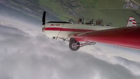 Pilot Performs aerobatics figures with passenger in small Yakovlev 52. stock footage