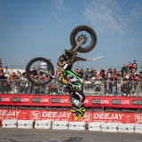 Pilot performs a backflip at EICMA 2013 in Milan, Italy. MILAN, ITALY - NOVEMBER 7: Trial pilot performs a backflip at EICMA, international motorcycle exhibition Royalty Free Stock Images