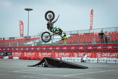 Pilot performs a backflip at EICMA 2013 in Milan, Italy Stock Images