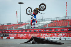 Pilot performs a backflip at EICMA 2013 in Milan, Italy Stock Image