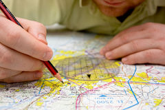 Pilot plotting a course on a map Stock Images