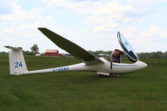 Pilot prepares his glider for start. Stock Images