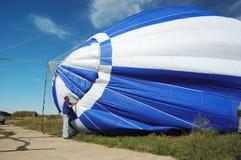Pilot is preparing to launch hot air balloon Stock Photos